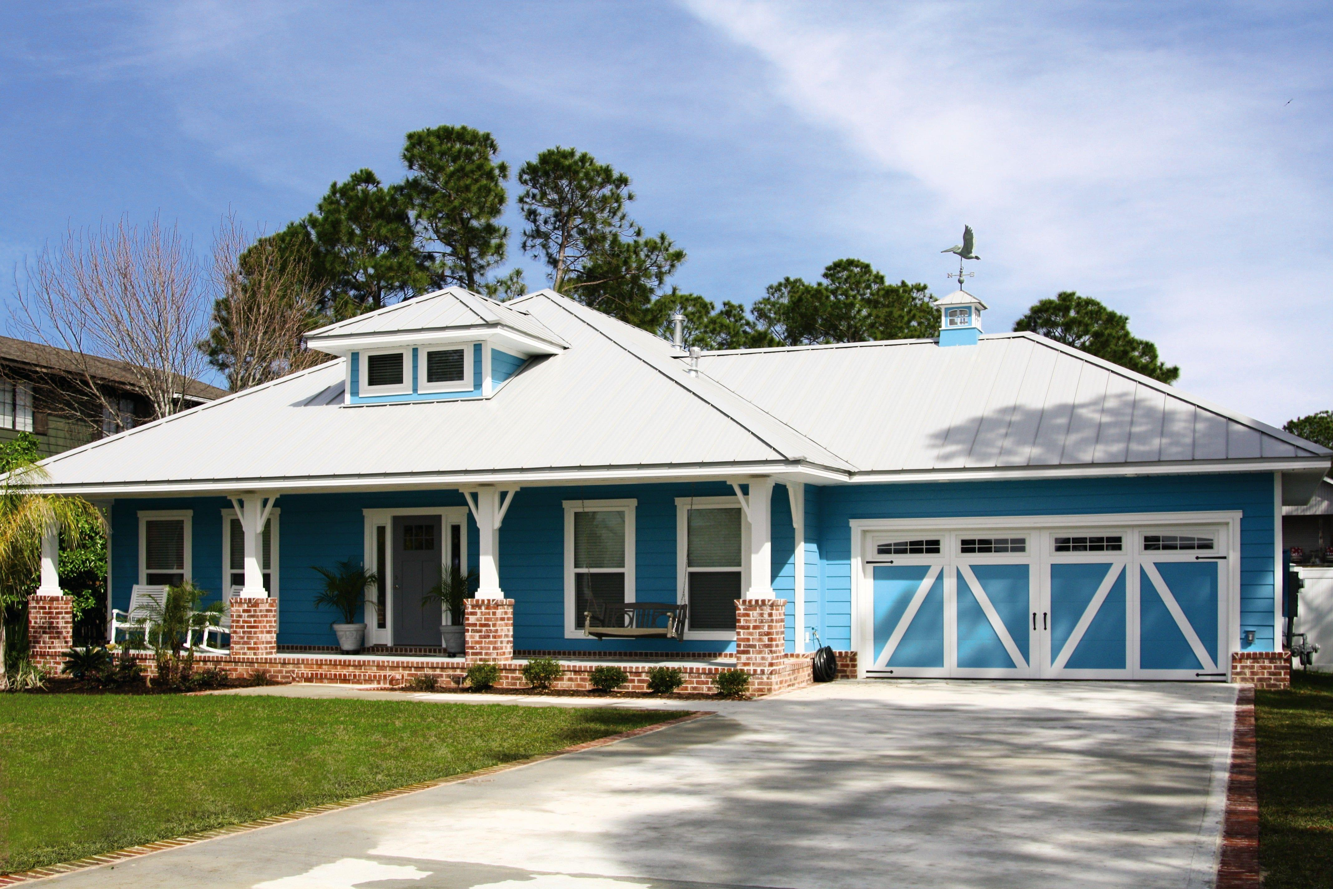 beautiful sky blue painting on home and ranch style garage doors