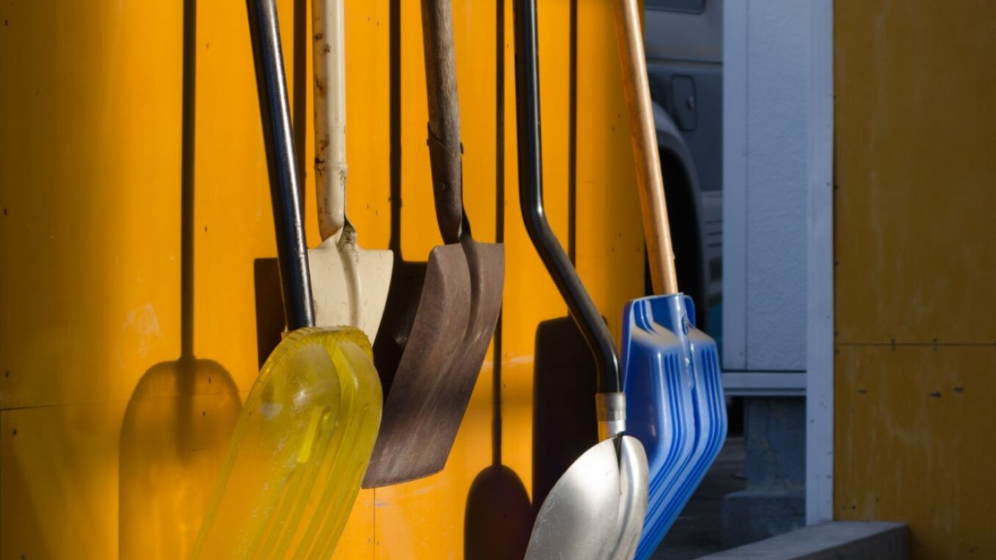 Creative-Door-Services_Cool-Storage-Tips_shovels-hung-up-on-garage-wall.jpg?mtime=20180927103437#asset:10175:c1440x810