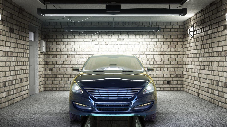 Black Car Lighted in Creative Door Garage