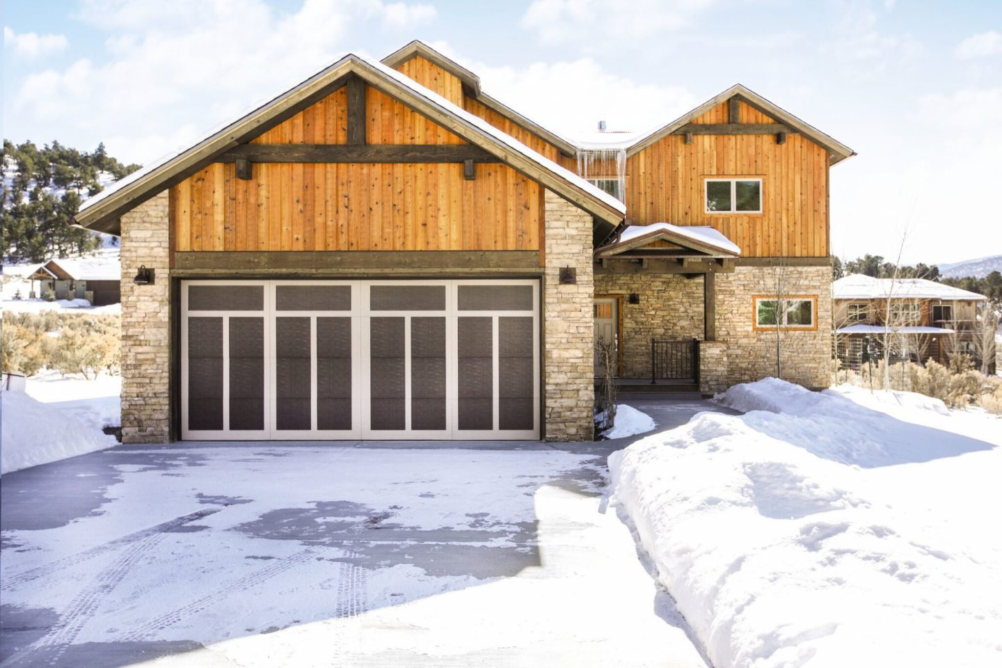 cabin-style-home-with-dark-wood-garage-door-in-the-winter.jpg?mtime=20181123162328#asset:10857:c1440xauto