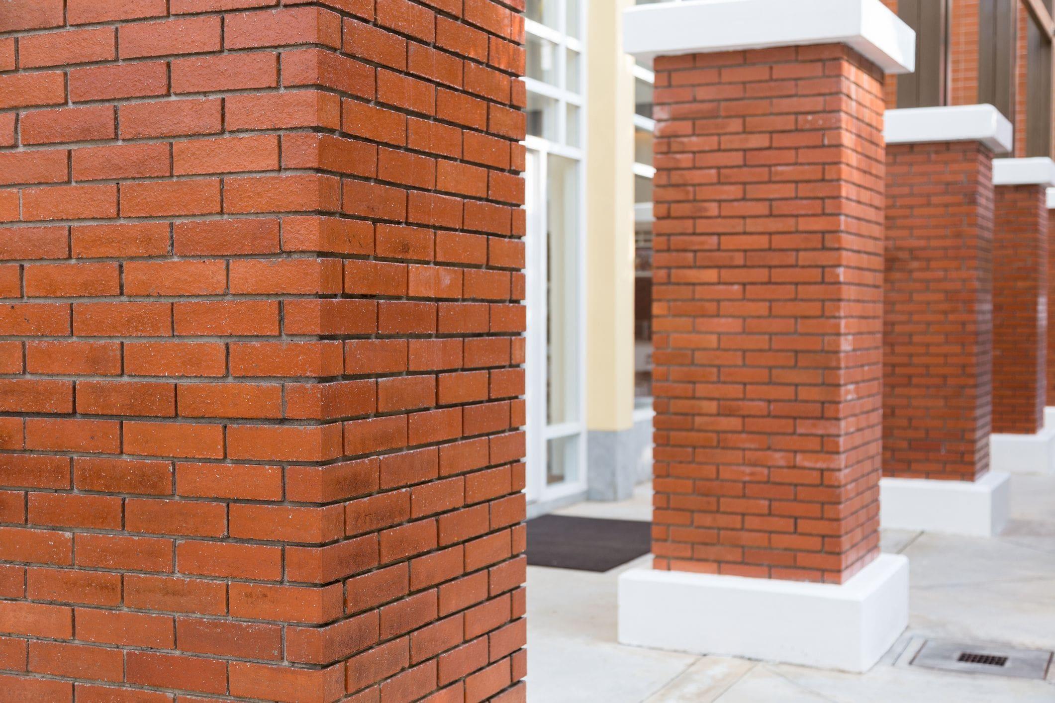 brick pillars at front entrance of home driveway