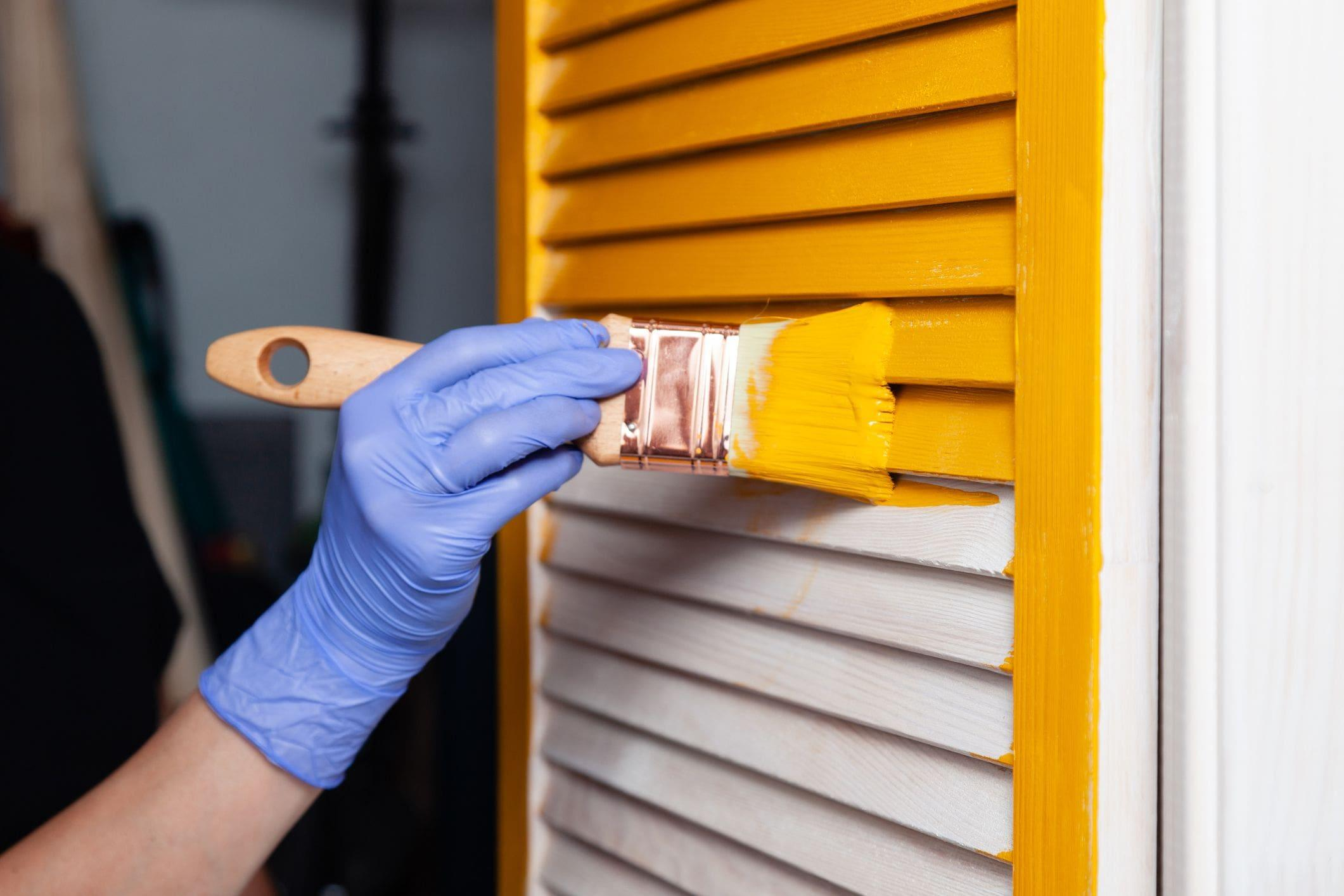 sunny yellow paint on brush for home