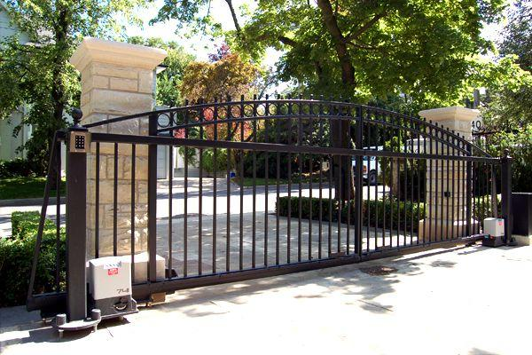 beautiful cantilever gate on a sunny residential property