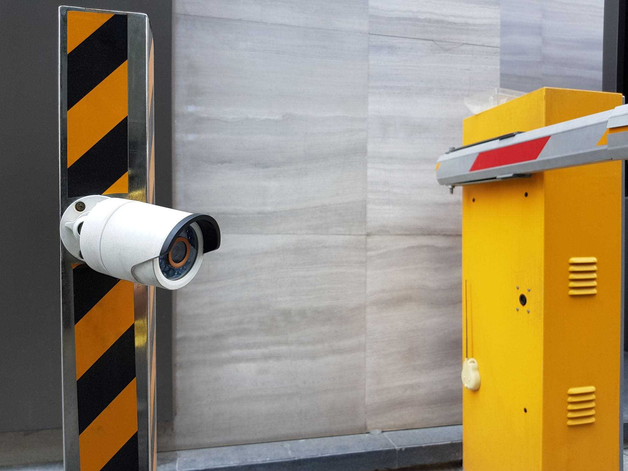 CCTV security camera at commercial automatic gate entrance