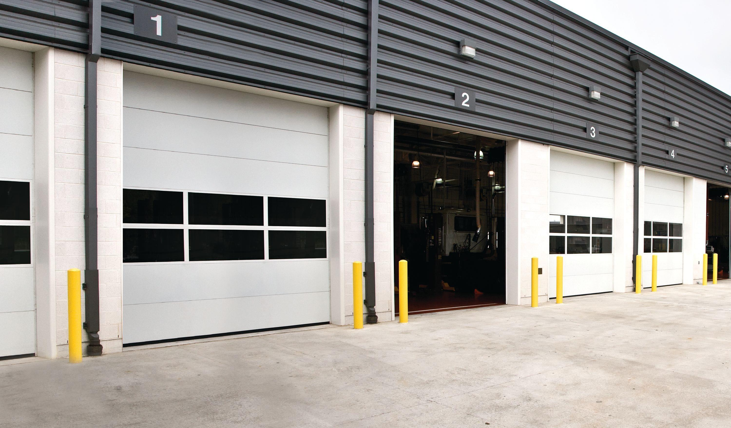 exterior of commercial building with row of overhead doors
