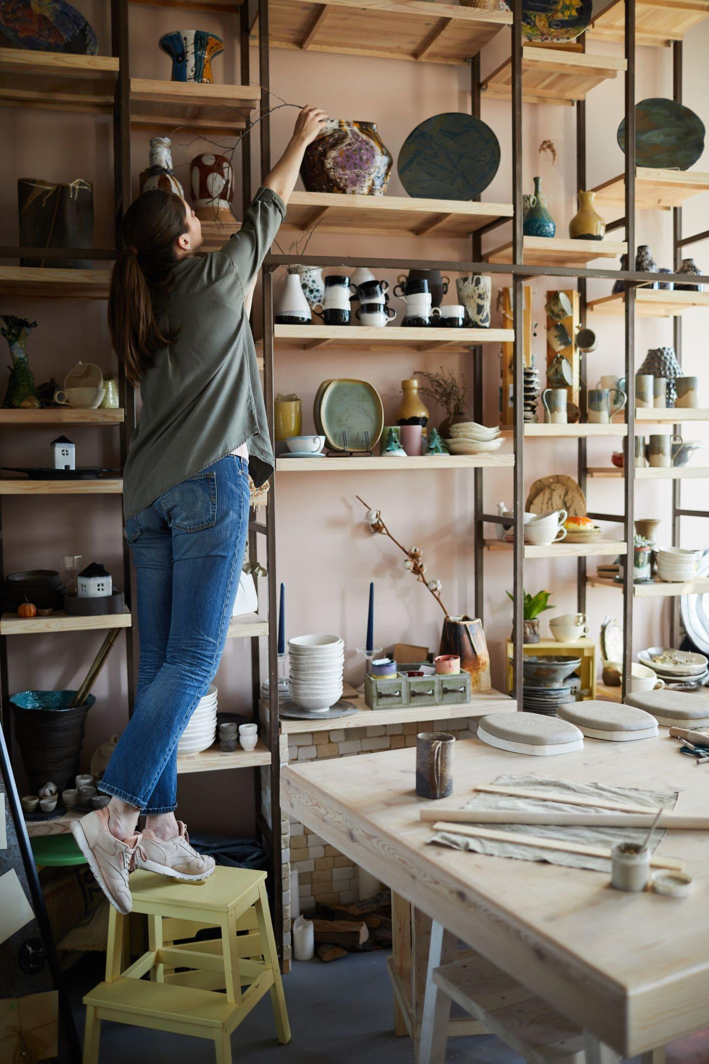 custom shelving display in tandem garage workshop