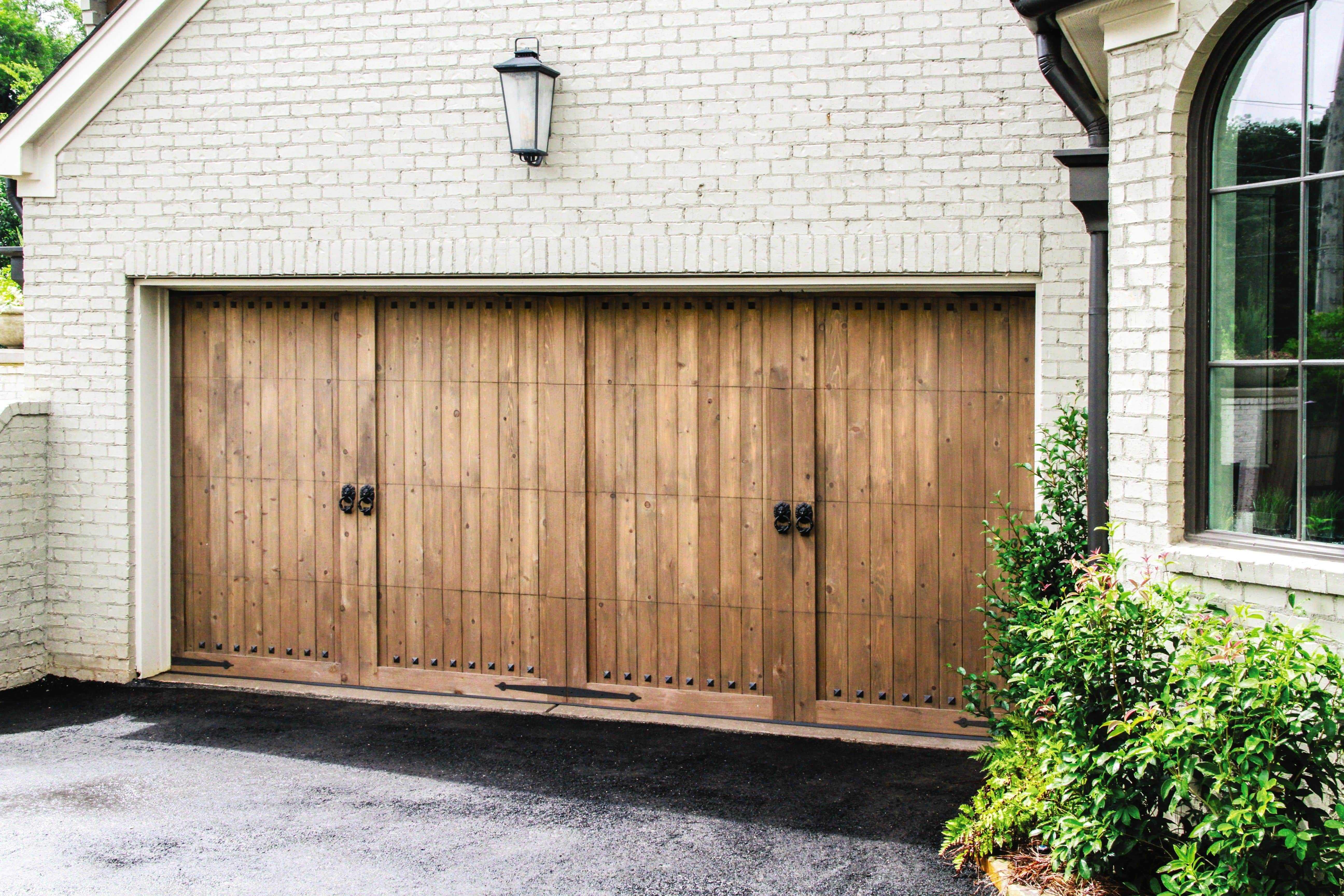 custom wood garage doors with antique handles