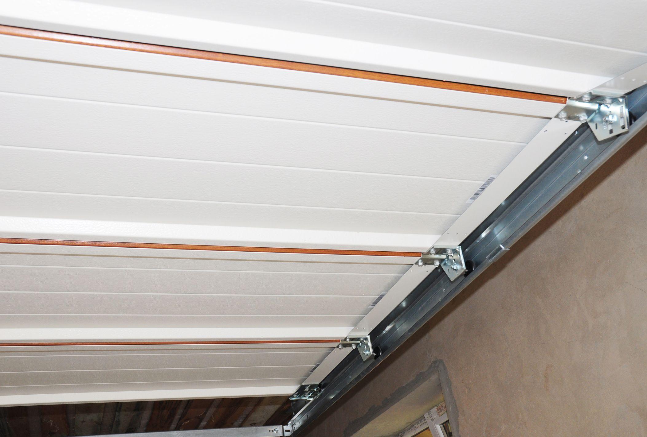 garage door overhead view of rollers on tracks