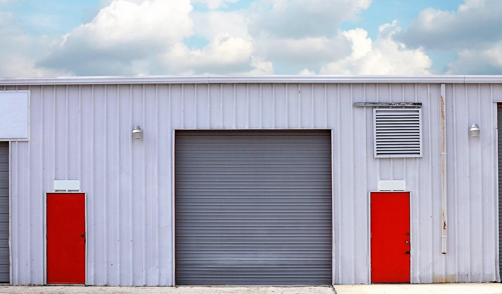 industrial warehouse with red pedestrian doors