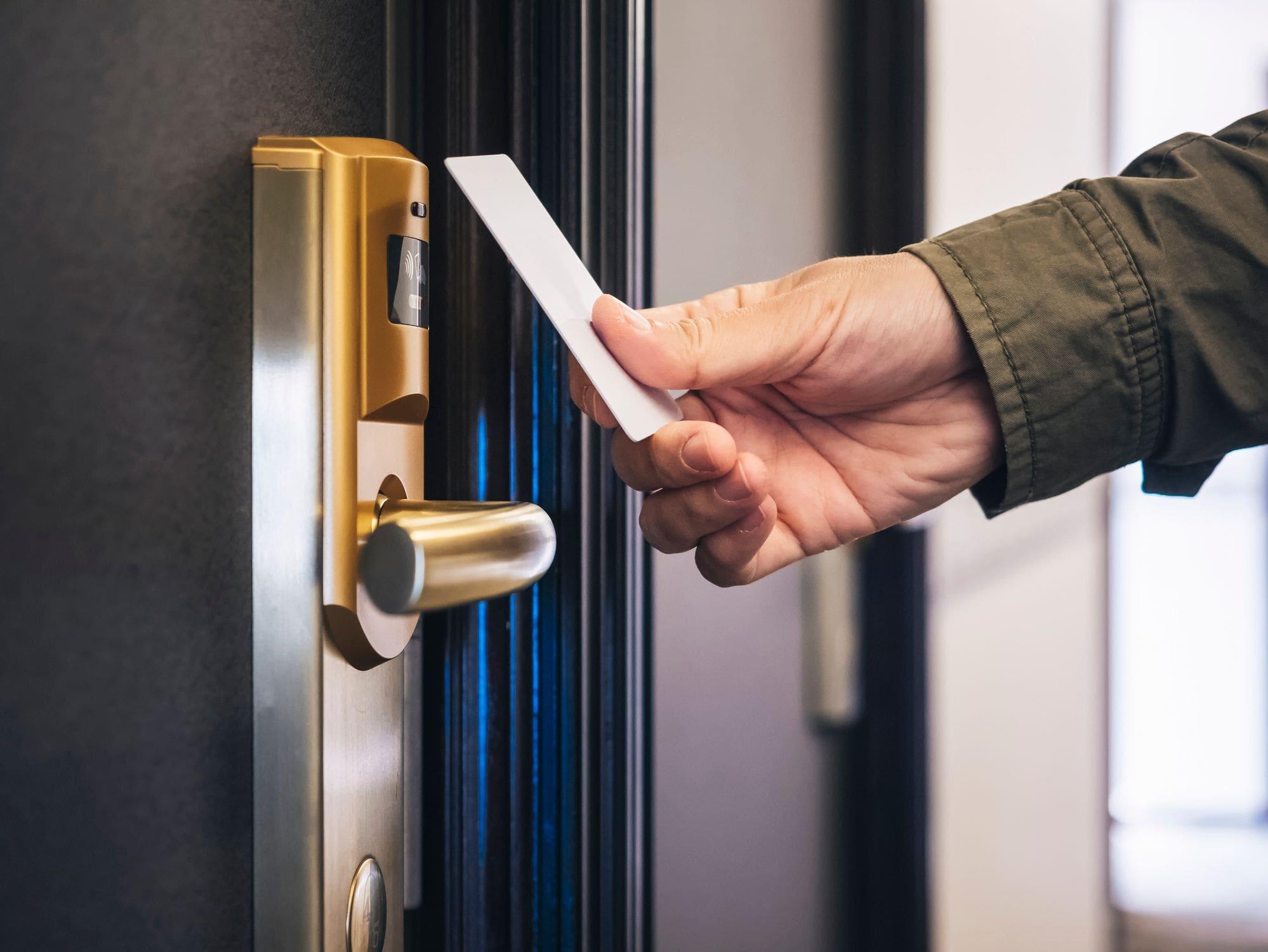 swiping keycard reader on door