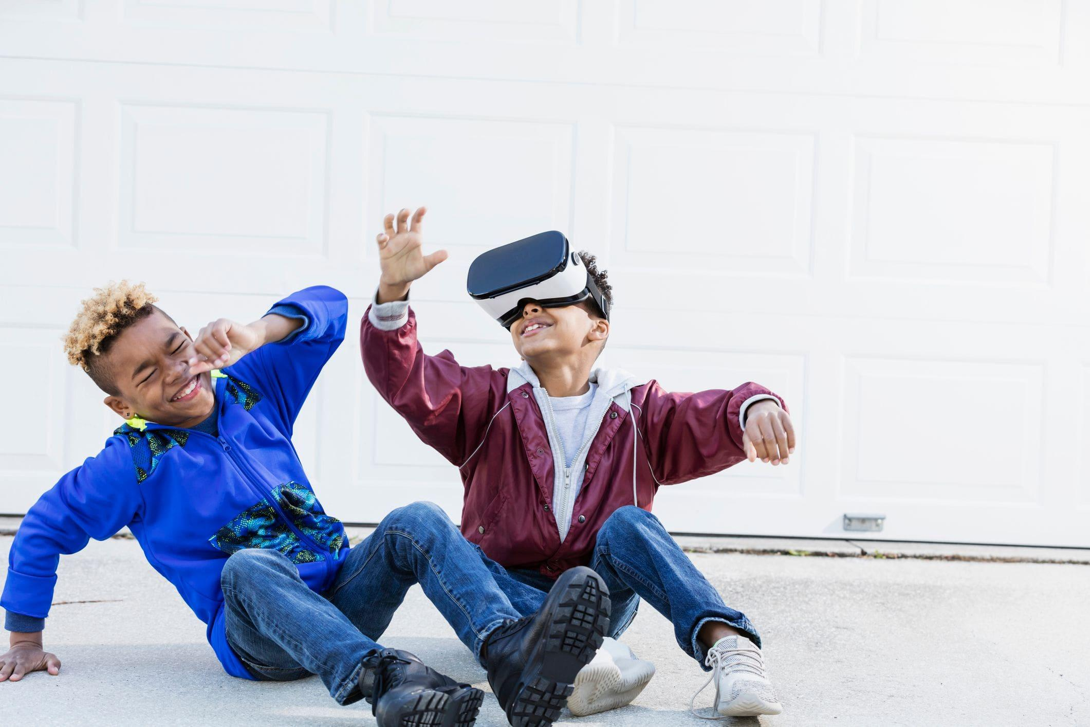 kids playing with a VR headset in garage