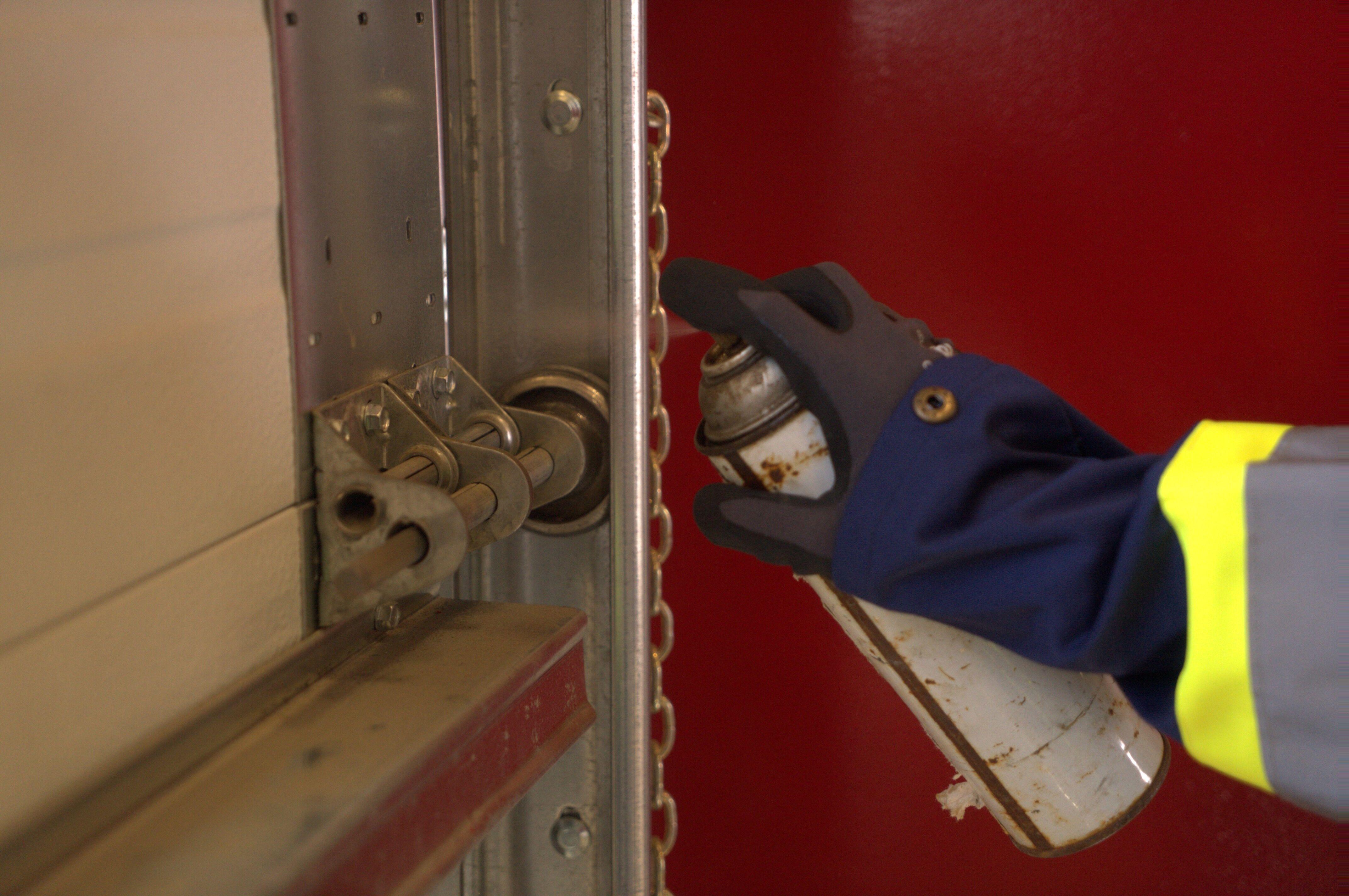lubricating garage door rollers