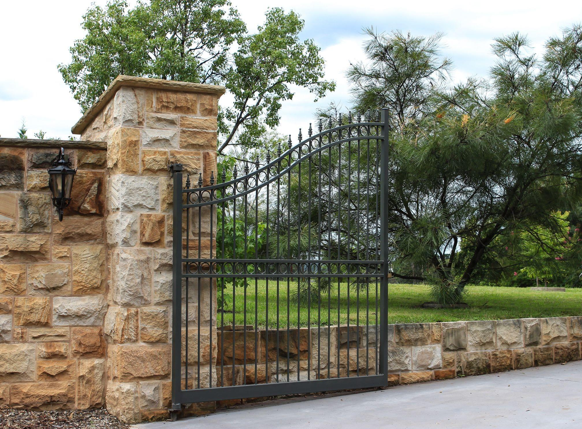 brick and metal residential gate open