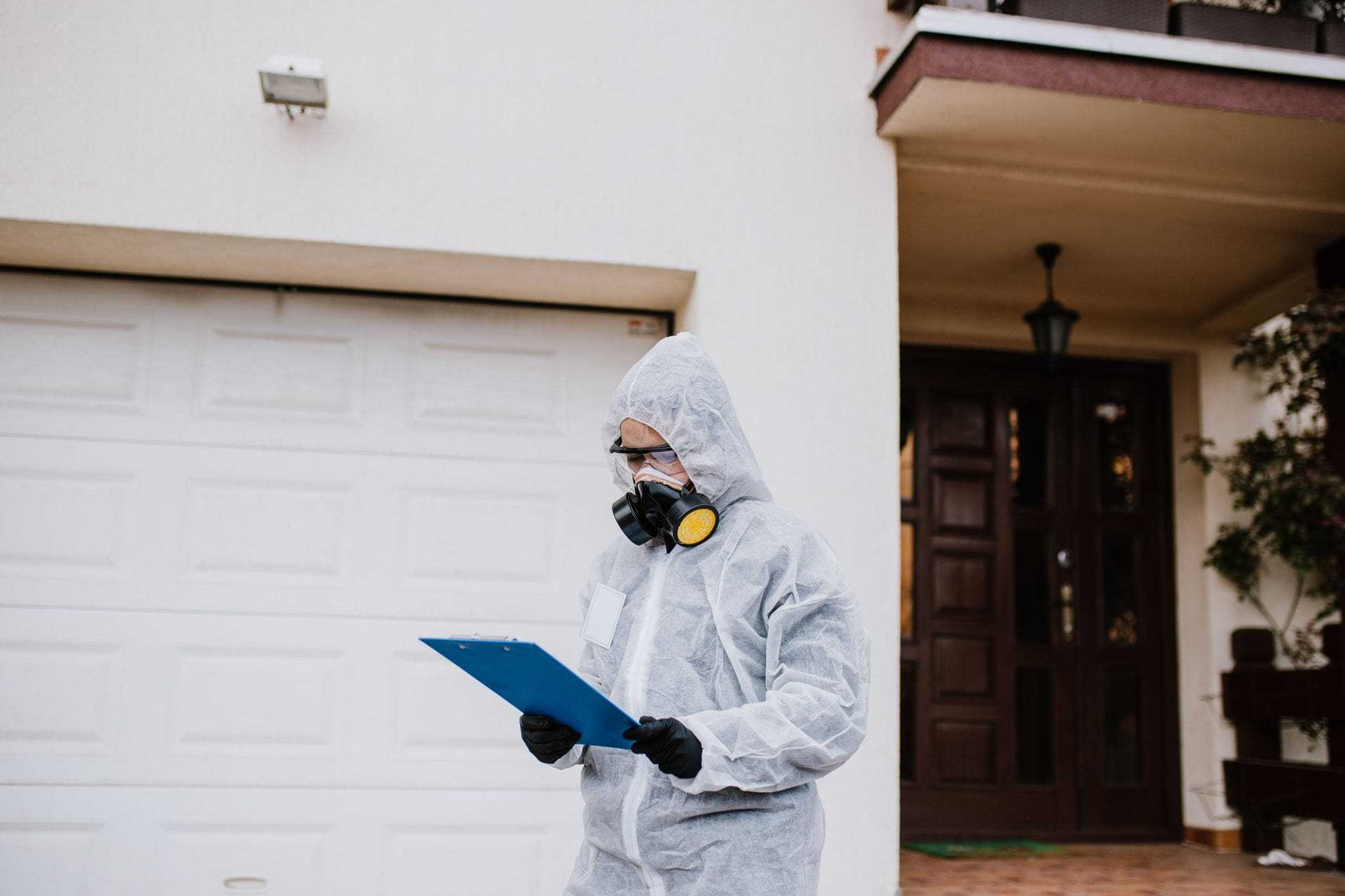 pest control inspector wearing protective gear