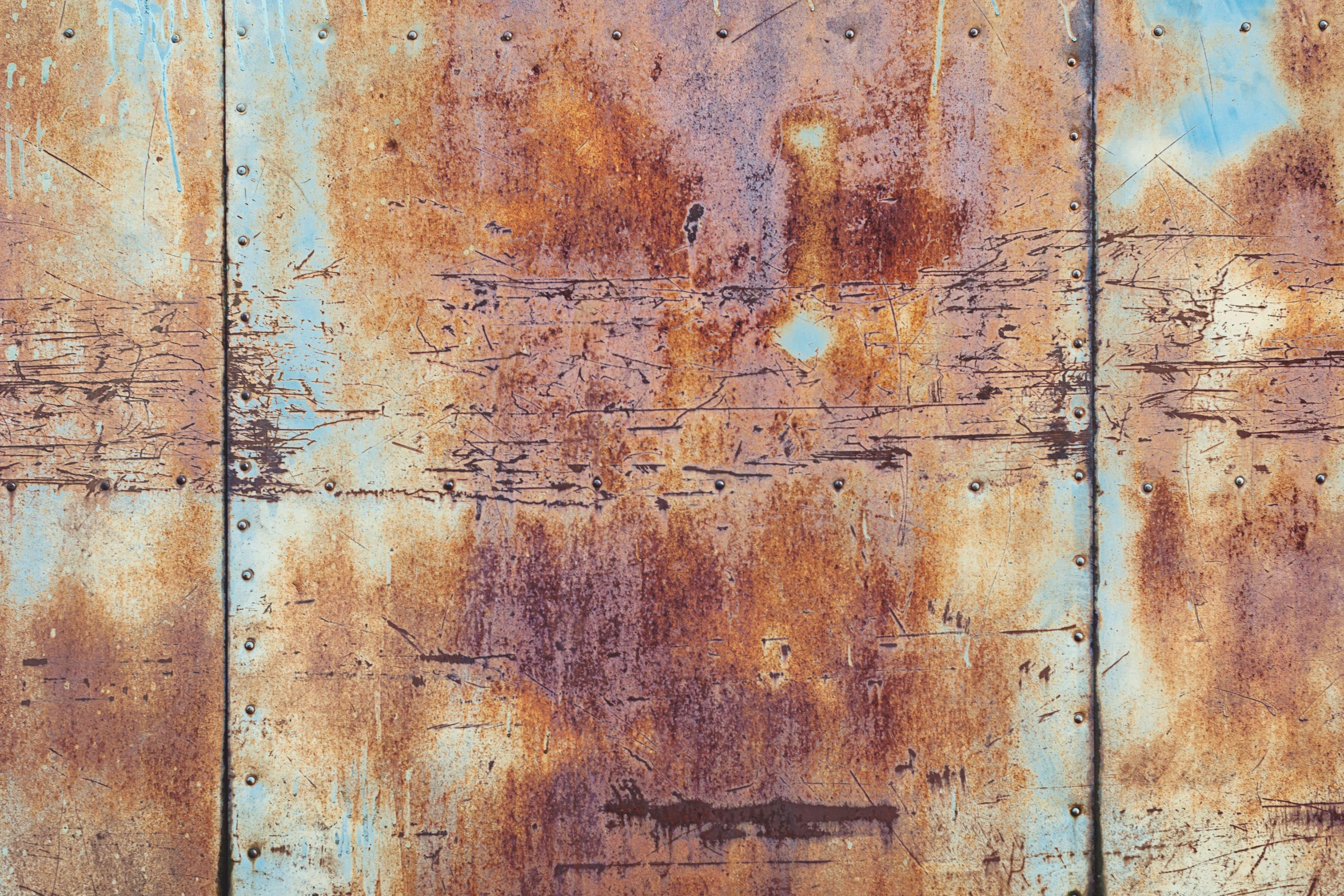 rusted panel of old sectional door