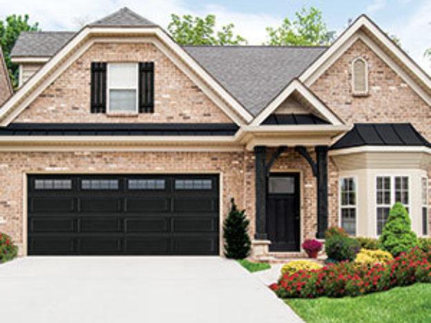 Brick House With Black Garage Door