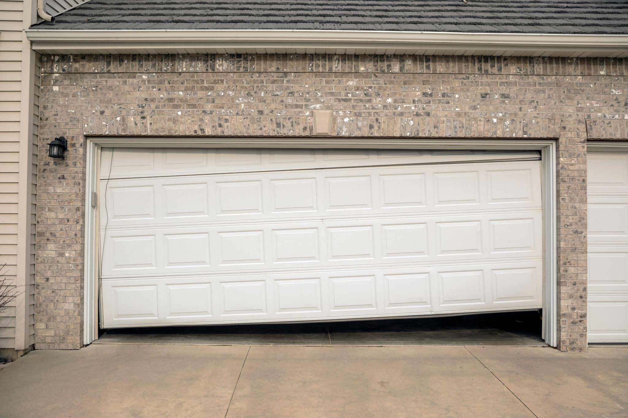 sagging and uneven garage door