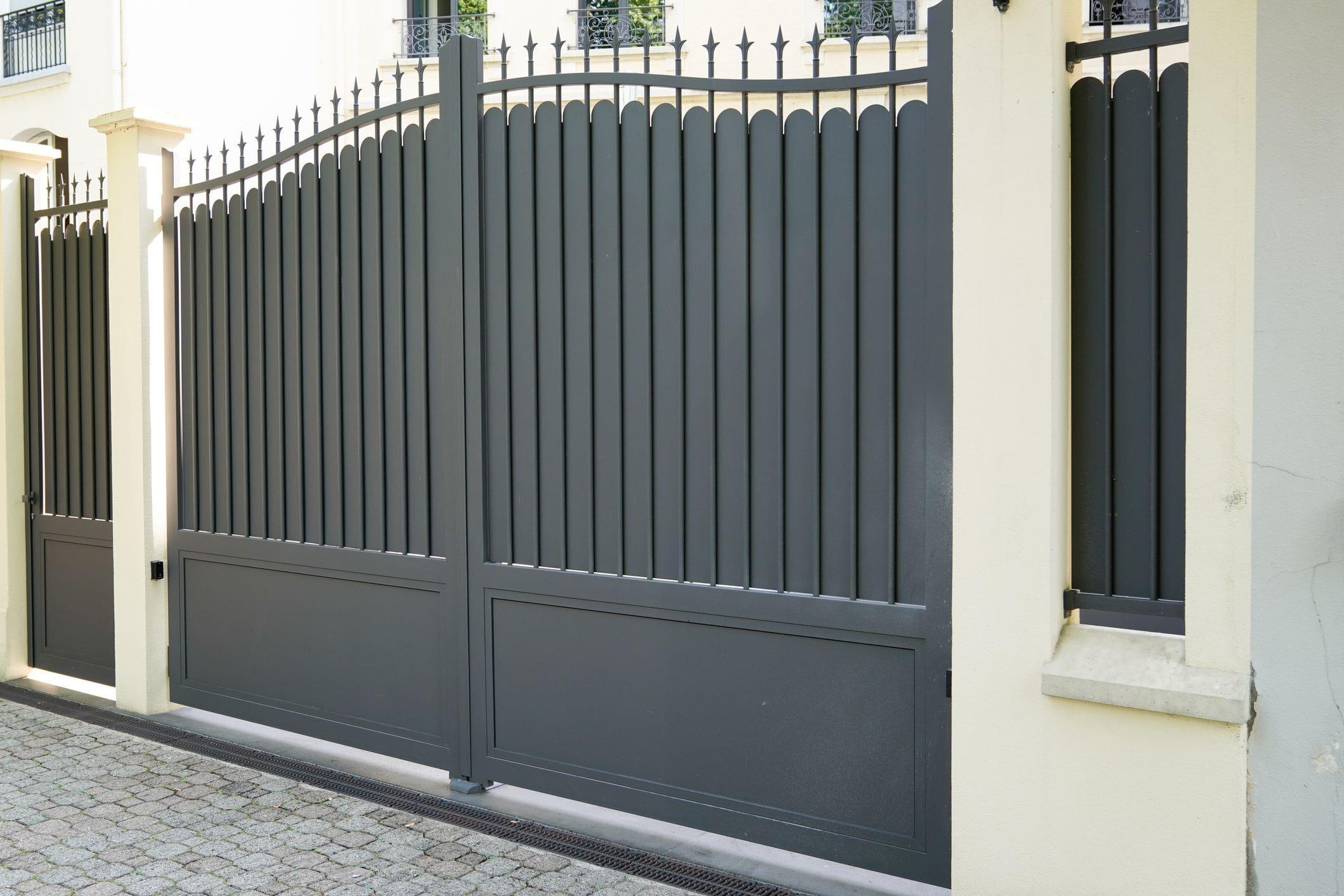 gorgeous modern ornamental steel automatic gate in front of home