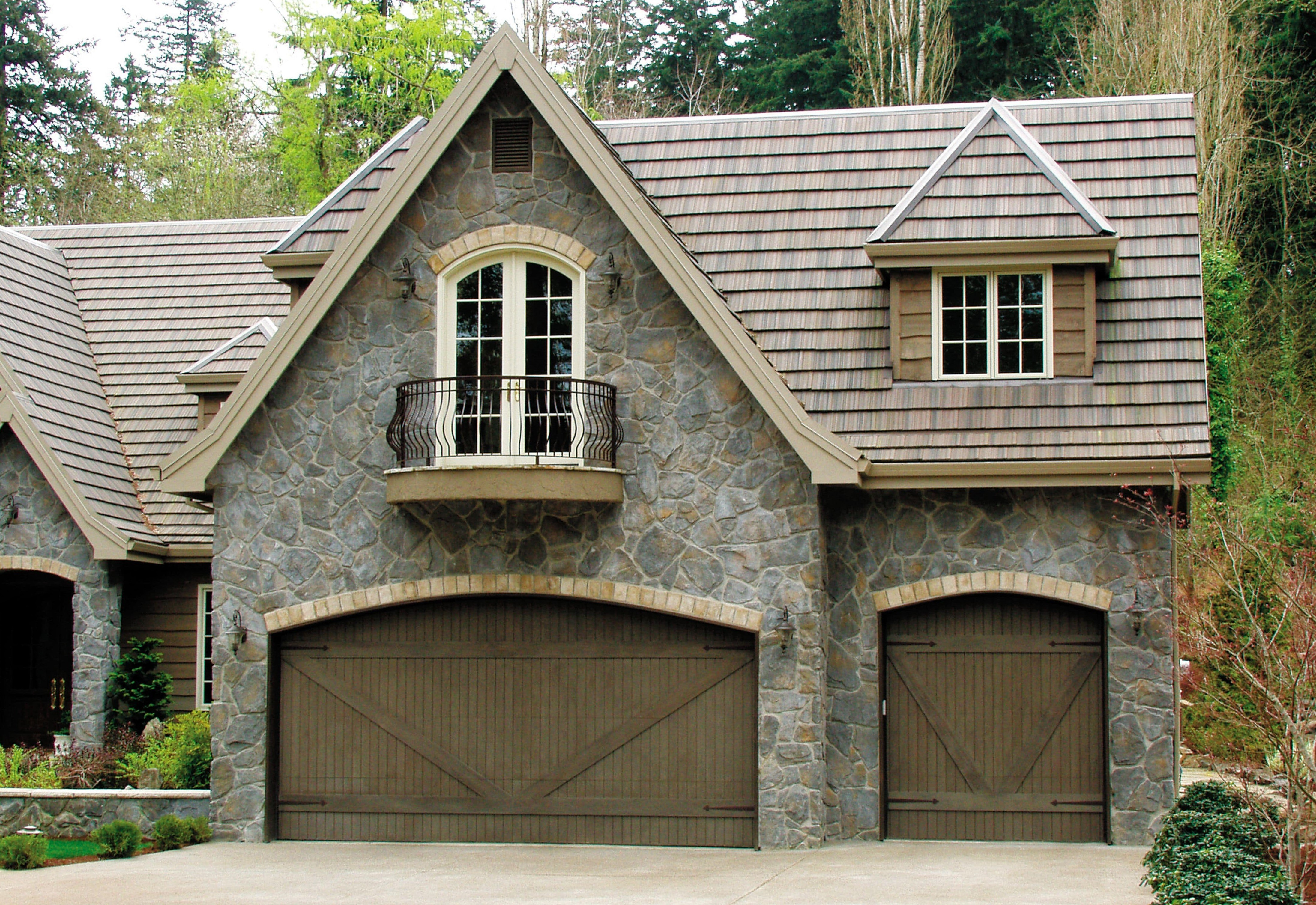 heritage house with custom wood garage doors