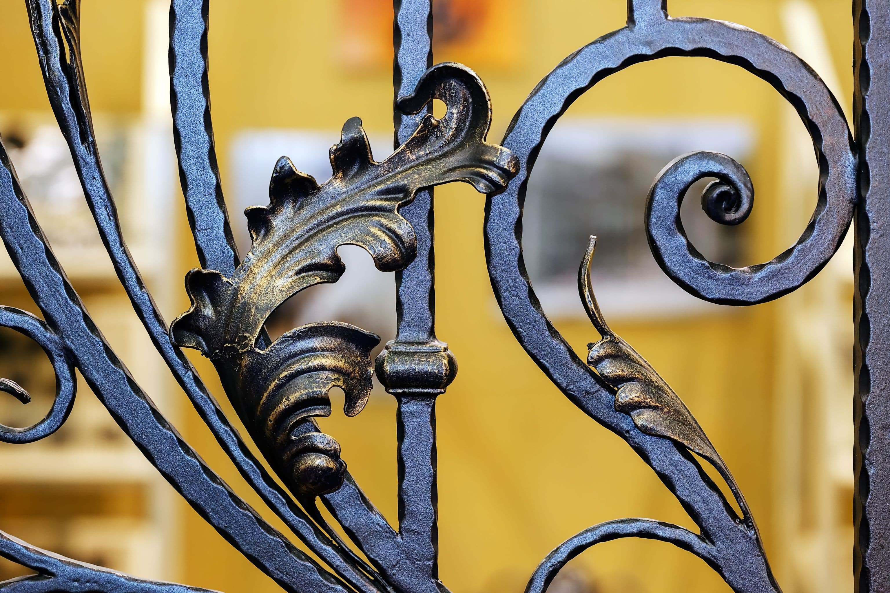 wrought iron details of ornamental gate