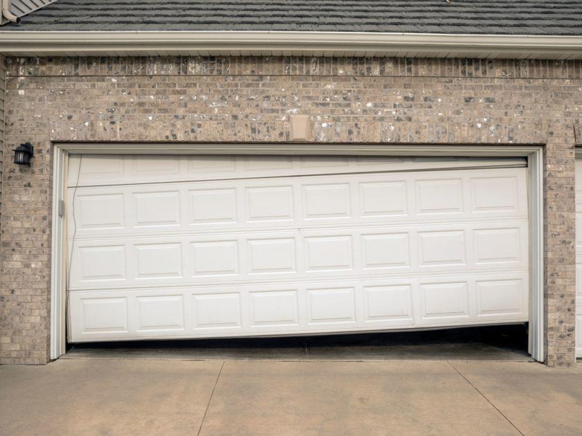 Help My Garage Door Is Uneven Or Sagging Creative Door
